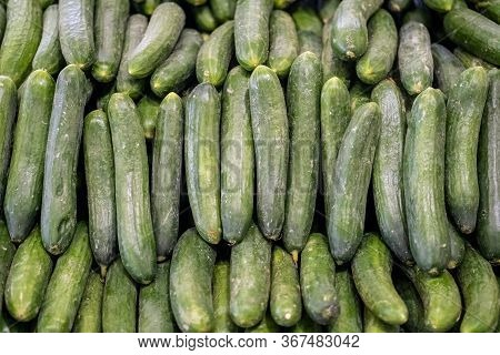 Top View Of Fresh Organic Cucumbers Harvested From The Farmer\'s Garden, Sold On A Local Grocery Mar
