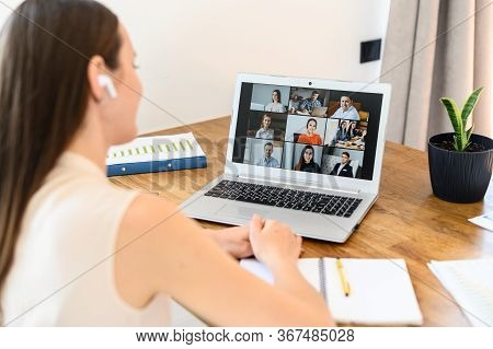 Virtual Video Conference, Online Meeting With A Many Employees Together. A Young Woman Is Communicat