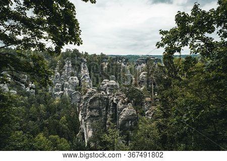 View Of Sandstone Cliff In Saxony Switzerland With Bastei Bridge. Summer Scene Rocky Mountains, Germ