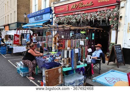 London, Uk - July 13, 2019: People Visit Jewelry Stall At Portobello Road Market In Notting Hill Dis