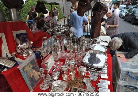 London, Uk - July 13, 2019: People Visit Antique Stall At Portobello Road Market In Notting Hill Dis