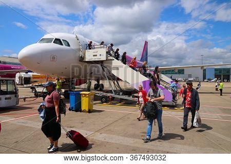 Luton, Uk - July 12, 2019: Passengers Disembark Wizz Air Airbus A320 Low Coast Plane At London Luton
