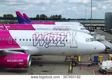 Luton, Uk - July 12, 2019: Wizz Air Airbus A320 Fleet At London Luton Airport In The Uk. It Is Uk's
