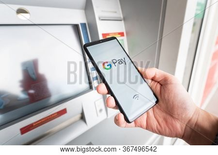 Wroclaw, Poland - Nov 06, 2019: Man Holding Smartphone With Google Pay Logo. Google Pay Is Electroni