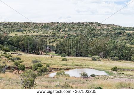 Ladybrand, South Africa - March 20, 2020: A Dam And A Chalet Is Visible From The Eland Hiking Trail