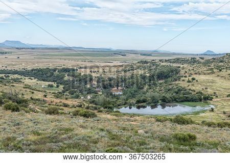 Ladybrand, South Africa - March 20, 2020: A Dam And Chalets Are Visible From The Zebra Hiking Trail