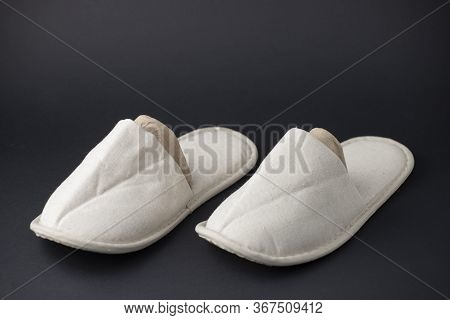 Comfortable Home Slippers On Black Background. Soft Comfortable Home Slipper. Stay At Home Concepts