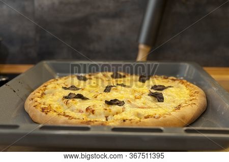 Baked Quattro Formaggi Pizza In Rectangular Oven Griddle.