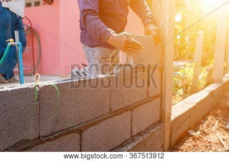 Masoners Constructing Masonry To Build Fences