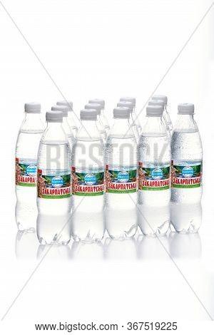 Kyiv, Ukraine, 04.04.2020: Fourteen Juicy Bottles Of The Zakarpatska Mineral Water With Drops On A W