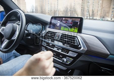 Modern Technology Concept, Road Assistance. Man Controls A 360 Surround View Assist System Of A Mode
