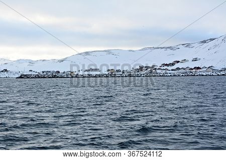 Skarsvag Is A Village In Nordkapp Municipality. The Village Lies Along The Northern Coast Of The Isl