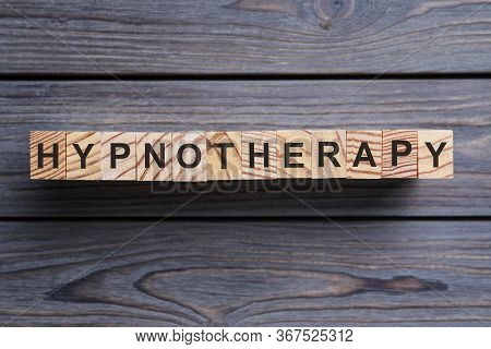 Blocks With Word Hypnotherapy On Wooden Background, Flat Lay