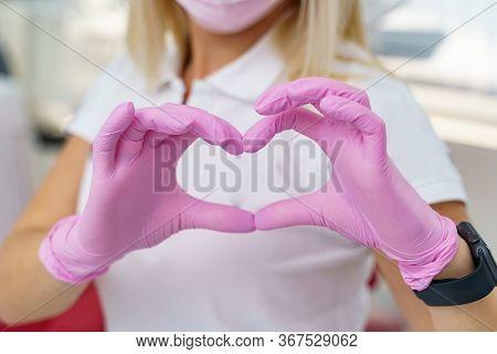 Female Doctors Hands Showing Heart Shape. Doctors Hands Closeup. Medical Help, Prophylaxis Or Insura