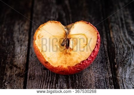 Red Wilted Rotten Half Apple Details On A Brown Wooden Surface
