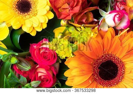 Bright Yellow And Orange Gerbera And Roses In A Bouquet Of Flowers. Beautiful Bouquet Gift For The H