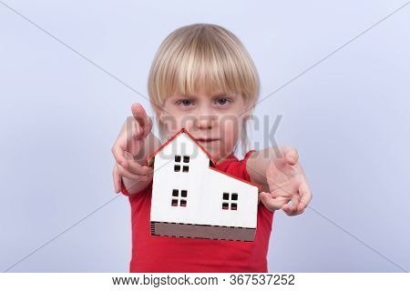 Sad Kid Throws Model Home. Orphanage, Orphan, Adoption.
