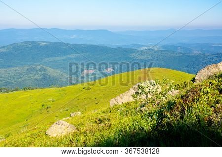 Mountain Summer Landscape. Meadow With Giant Sharp Stone Among The Grass On The Edge Of A Hill