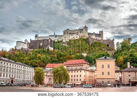 Salzburg/Austria - October 4, 2014. Scenic view of the Hohensalzburg fortress, Salzburg, Austria. The Kapitelplatz square with famous Hochensalzburg castle view.