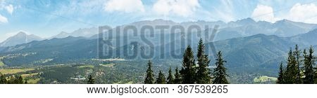 High Tatra Mountain Ridge. Poland Travel Destination. Beautiful Summer Panoramic Landscape In Evenin