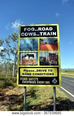 Dimbulah, Queensland/australia-may 11, 2020:  An Unusual Road Sign Depicting Various Dangers Ahead P