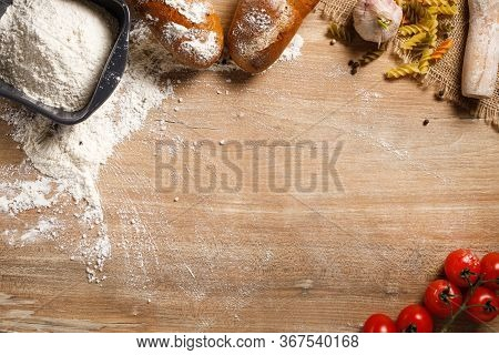 Flour Products On A Wooden Table With Copying Space. Flour, Pasta, Bread With A Rolling Pin. Top Vie
