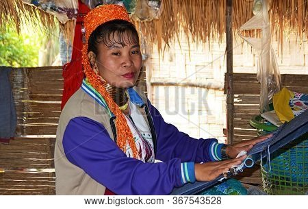 Baan Tong Luang / Thailand - January 19, 2020: Thai Long-neck Kayan Woman (giraffe Woman) Works On T