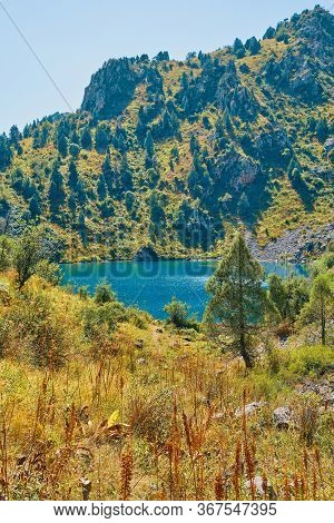 Lake In The Mountains. View Of The Lacustrine High In The Upland. Happy International Mountain Day.