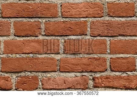 Seamless Dark Red Brick Wall Texture Background For Design. Pattern Of Weathered Old Cracked Brickwa