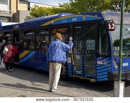 Bronx, New York/usa - May 20, 2020: Man With Cane Is Denied Front Entrance To Mta Bus Due To The Cor