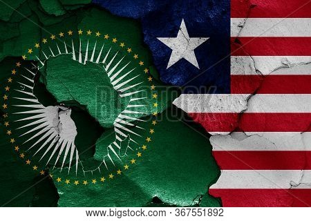 Flags Of African Union And Liberia Painted On Cracked Wall