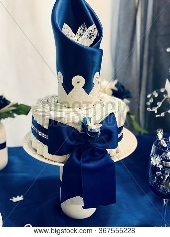 Image Of An Elegant Baby Shower Diaper Cake. Featuring A Navy /royal Blue Diaper Cake Theme With Sil