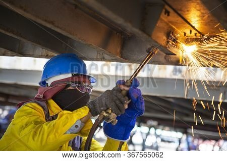 Worker Is Cutting Manually Old Metal Construction In Container By Using Gas Mixture Of Oxygen And Ac