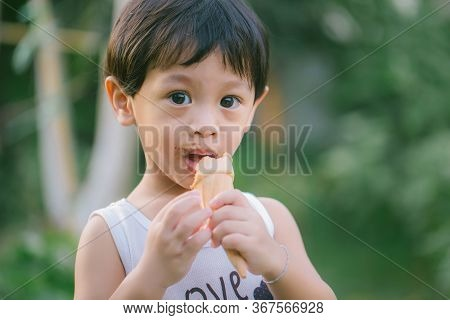 Asia Boy He Mouth Aftertaste From Eating Chocolate Ice Cream Or Chocolate Dessert. A Sweet-toothed C
