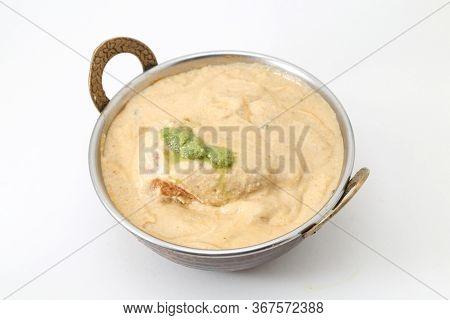 White Gravy Malai Kofta In A Copper Brass Bowl