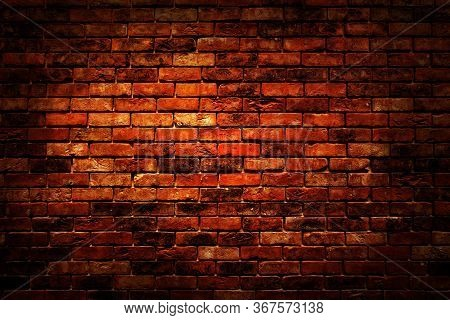 Red Brown Vintage Grunge Brick Wall Texture Background With Light Shading On Wall.