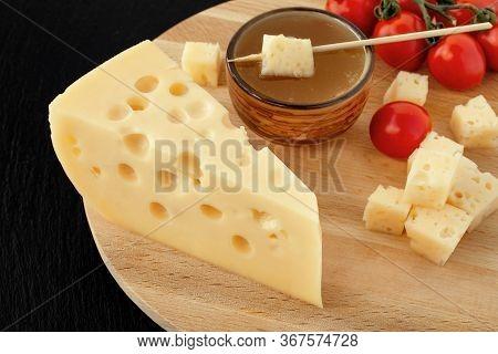 Yellow Maasdam Cheese, Triangular Piece Cheese With Holes, Saucer With Honey, Tomato Wooden Black Da