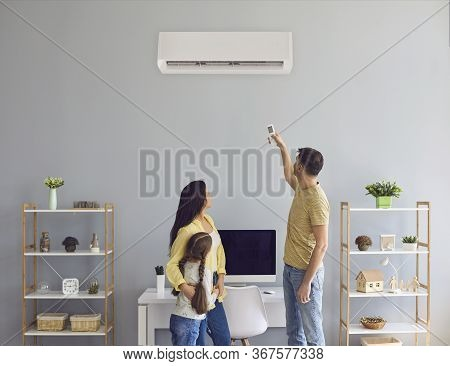 The Family Uses Air Conditioning At Home. Back View.