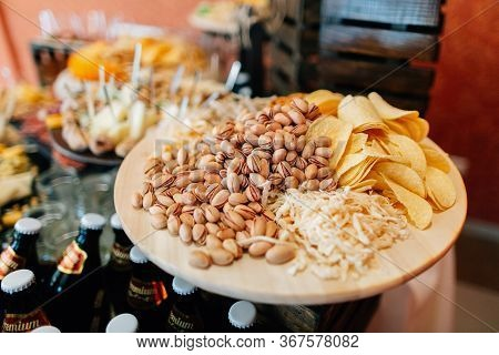 Pistachio And Chips On Catering Table. Catering Table Decoration
