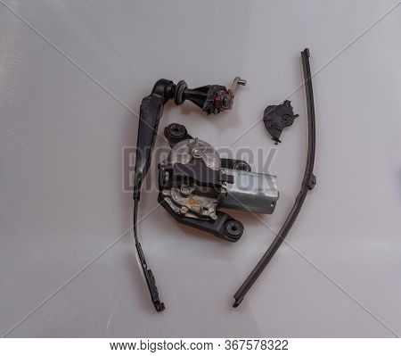 Front Side Of A Broken Tail Wiper After A Visit By Car In The Car Wash With Wiper Arm And Wiper Blad