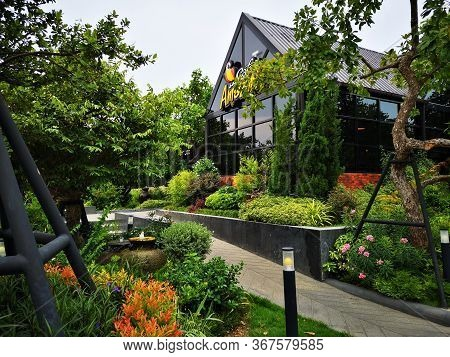 Samutsakorn, Thailand - May 23, 2020 : Cafe Amazon Coffee Shop With Nature Environment . Cafe Amazon