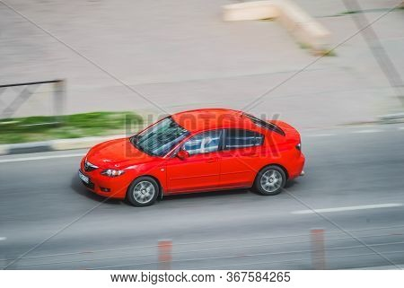 Moscow , Russia - May 15, 2020: Red Mazda 3 On The City Road. Fast Moving Car On The Street. Vehicle