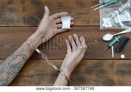 Drug Traffickers Were Arrested Along With Their Heroin. Police Arrest Drug Dealer With Handcuffs