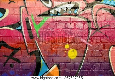 Abstract Colorful Fragment Of Graffiti Paintings On Old Brick Wall. Street-art Composition With Part