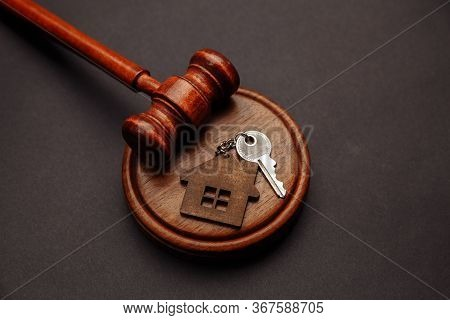 Judge Gavel And Key Chain In Shape Of Two Splitted Part Of House On Wooden Background. Concept Of Re