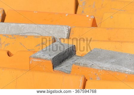 Orange And Concrete Barriers To Prevent Vehicular Terrorism Used To Line A Street In A Close Up Full