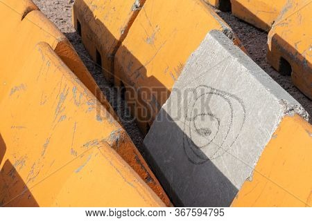 Close Up On Orange And Concrete Traffic Barriers To Protect Pedestrians From Vehicular Terrorist Att