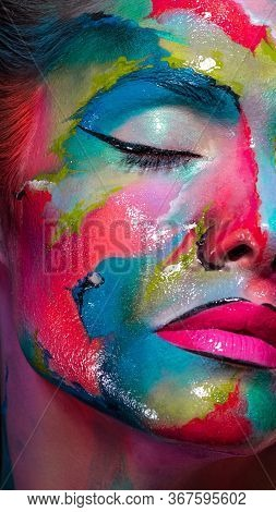 Face Art And Body Art. Creative Makeup With Colorful Patterns On The Face. Modern Makeup Art, Bold S