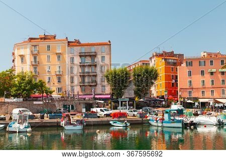 Ajaccio, France - July 6, 2015: Ajaccio Port. Coastal Cityscape With Colorful Houses And Wooden Boat