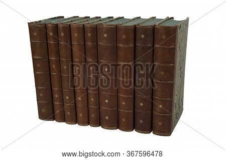 Isolated Set Of Old Leather Antique Books Standing Upright In A Row On A White Background